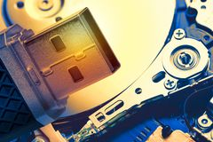 Toned image of USB memory stick against hard disk drive plate background. Technology concept stock images