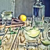 Toned image. Vodka, tequila, gin. Alcoholic cocktail with ice and lime or lemon Stock Images