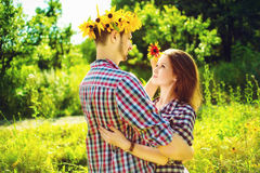 Toned image of young happy couple in love playing Stock Photos