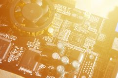 A toned macro image of a computer board with many small technological elements. Extremely shallow depth of field. Abstract techno. Logical background stock images