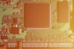 A toned macro image of a computer board with many small technological elements. Extremely shallow depth of field. Abstract techno. Logical background royalty free stock photos