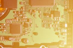 A toned macro image of a computer board with many small technological elements. Extremely shallow depth of field. Abstract techno. Logical background royalty free stock photography