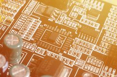 A toned macro image of a computer board with many small technological elements. Extremely shallow depth of field. Abstract techno. Logical background stock photos