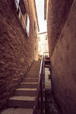 Toned photo of big stairway at narrow street Stock Photo