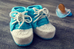 Toned photo of blue crocheted bootees. Stock Images