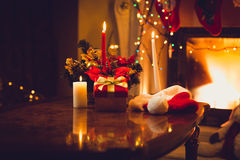 Toned photo of burning candles, fireplace and giftbox at christm Royalty Free Stock Photos