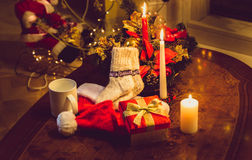 Toned photo of christmas candles, open giftbox and woolen socks Royalty Free Stock Images