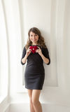 Toned photo of cute girl posing with red heart at white interior Royalty Free Stock Photography