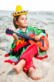 Toned photo of Little happy smiling boy plays his. Guitar Stock Images