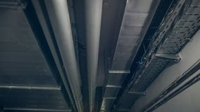Free Toned Photo Of Air Ventilation Pipes And Electric Wires On Ceiling At Industrial Fabric. ABstract Grungy Background Royalty Free Stock Photo - 148831015