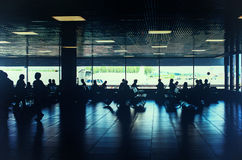 Toned photo of people waiting for departure in the airport Royalty Free Stock Images