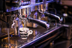 Toned photo preparing cup of coffee with coffee machine, background for coffee shop Royalty Free Stock Images