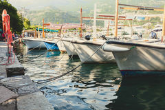 Toned photo of row of moored fishing boats Stock Image