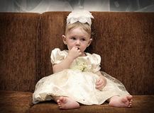 Sad Baby on Sofa Stock Photography