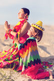 Toned photo of son and mother dressed in Mexican Stock Images