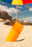 Toned photo of suntan lotion on sandy beach at sunny day Stock Images