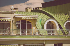Toned photo of terrace under green metal roof at classic buildin Stock Image