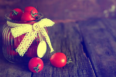 Toned photo tomato cherry in a glass jar Stock Images