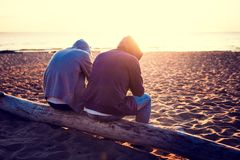 Two Guys outdoor. Toned Photo of Two Men on the shore at Sunset Royalty Free Stock Images