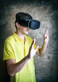 Young Man in VR Glasses Stock Image
