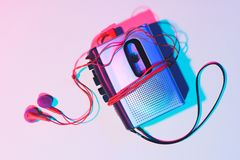 Toned picture of retro cassette player and earphones. On tabletop stock images