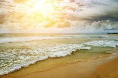 Toned picture sea landscape in vintage style. Bright sun on dramatic sky over ocean Stock Photo