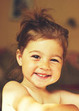 Toned portrait of a beautiful little girl smiling Stock Photography