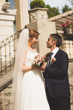 Toned portrait of bride and groom looking at each other Stock Photo
