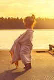 Toned portrait of Cute little girl is watching at the sea at sunset Royalty Free Stock Photography