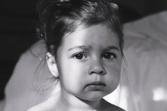 Toned Portrait of cute sad little girl thinking. Royalty Free Stock Photography