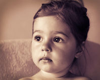 Toned portrait of Cute sad little girl thinking Stock Images