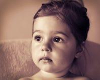 Toned portrait of Cute sad little girl thinking. Toned portrait of pretty sad little girl thinking Stock Images