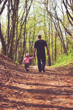 Toned portrait of Father and daughter walk in the forest at summer Royalty Free Stock Photos