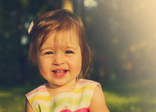 Toned portrait of happy cute smiling girl . Toned Stock Images