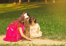 Toned portrait of  little kids having fun in beautiful park at sunset Royalty Free Stock Photos