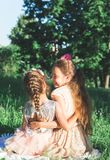 Toned portrait of Two Happy little girls embracing and spending. Toned portrait of Two Happy cute little girls embracing and spending time at sunny summer park Stock Photos