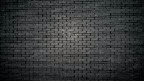 Toned shot of black brick wall on old building Stock Photos