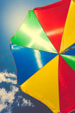 Toned shot of colorful umbrella against blue sky Royalty Free Stock Images