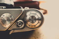 Toned shot of metal buttons and controls on vintage film camera. Macro toned shot of metal buttons and controls on vintage film camera royalty free stock photos
