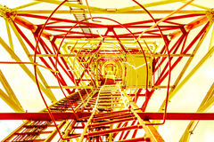 Toned to yellow golden steel construction as many triangles view from below Stock Photography