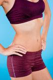 Toned Torso in Purple Sportswear Royalty Free Stock Photo