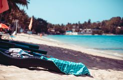 Toned view of the tropical beach with the sunbed and mess on it stock image