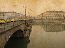 Toned vintage bridge leads to a piazza in Italy Stock Photo