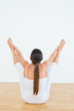 Toned woman doing the balancing bear posture Royalty Free Stock Photography
