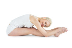 Toned woman doing the paschimottanasana pose Royalty Free Stock Images
