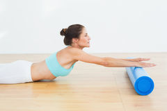 Toned woman doing stretching exercise in fitness studio Royalty Free Stock Image