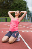 Toned woman doing stretching exercise on the running track Royalty Free Stock Images