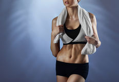 Toned woman sweating after her workout Stock Photos