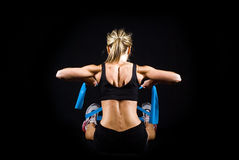 Toned young fitness woman working out. Royalty Free Stock Photo