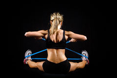 Toned young fitness woman working out. Stock Image